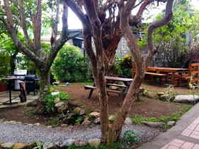 Out door seating, eating and relaxing area by entrance gate of Refugio del Rio.© Tey-Marie Astudillo 2014.